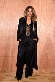Ciara arrived for the Givenchy fashion show wearing a boudoir-chic satin pantsuit from the label.