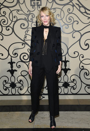 Cate Blanchett looked playfully business-chic in a lip-patterned pantsuit by Givenchy during the brand's Spring 2018 show.