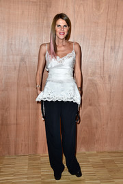 Anna dello Russo completed her outfit with slouchy black slacks, also by Givenchy.