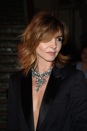 Clotilde Courau adorned her bare neckline with a stunning diamond chandelier necklace.