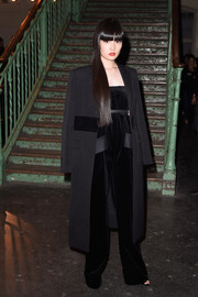 Kozue Akimoto attended the Givenchy show all covered up in a bulky black coat.