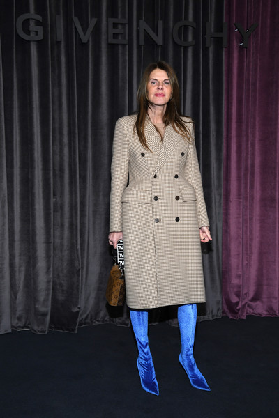 Anna dello Russo showed off her signature OTT style in a beige Balenciaga micro-houndstooth coat with exaggerated hips at the Givenchy Fall 2018 show.