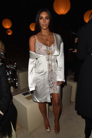 Kim Kardashian sent pulses racing at the Givenchy show with this see-through white lace dress from the brand.