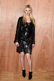 Lara Stone chose a pair of black Givenchy cutout oxfords to complete her look.