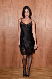 Julia Restoin-Roitfeld looked foxy at the Givenchy fashion show in a little black cami dress with a lace neckline and hem.