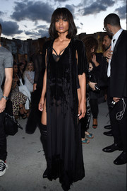 Ciara looked super seductive at the Givenchy fashion show in a sheer black velvet-burnout maxi dress with open sides that barely disguised the bodysuit underneath.