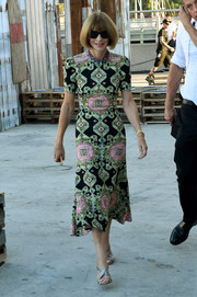 Anna Wintour headed to the Givenchy fashion show wearing a stylish geometric-print dress.