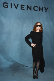 Isabelle Huppert attended the Givenchy Spring 2019 show wearing a ruched, long-sleeve LBD.