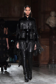 Joan Smalls unleashed her inner cowgirl in a fringed leather and velvet jacket on the Givenchy runway.