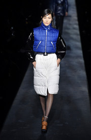 A white puffer skirt completed Liu Wen's outfit.