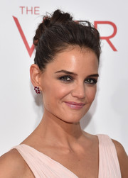 Katie Holmes paired her updo with gorgeous Lorraine Schwarts ruby and diamond studs.