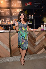 Tiffani Thiessen looked stunning in a figure-flattering rainforest-print frock, which she wore to the Glad One Bag event in LA.