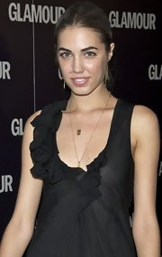 Amber Le Bon wore a long chain necklace with a gold pendant at the Glamour 2011 Beauty Awards.