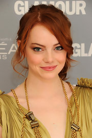 Emma Stone wore her fiery tresses in a pretty ponytail with face-framing tendrils at the 'Glamour' Women of the Year Awards.