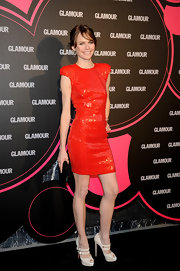 Veronica Blume paired her Christian Louboutin pumps with a fabulous orange sequin dress.