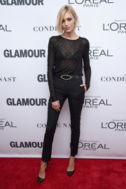 Anja Rubik completed her sleek look with black cigarette pants.