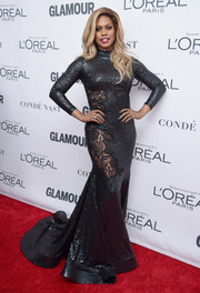 Laverne Cox looked phenomenal in a gunmetal-gray sequin and lace mermaid gown by Stello at the 2017 Glamour Women of the Year Awards.