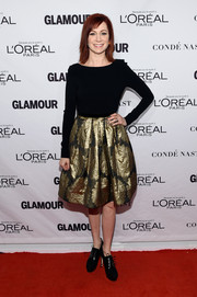 Carrie Preston opted for a black and gold cocktail dress with a floral brocade skirt when she attended the Glamour Women of the Year Awards.