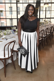 Danielle Brooks dressed up her top with a pleated black-and-white maxi skirt by Eloquii.