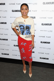 Yara Shahidi dressed up her T-shirt with an embellished red angora pencil skirt by Prada.