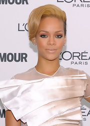 The 'Rated R' singer sported honey-hued short hairstyle with her structured ensemble. Her hair was side-parted and softly waved to create an elegant face-framing look.