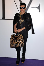 As if his furry leopard print bag wasn't enough eye candy, Bryan Boy topped his look off with loads of gold chains.