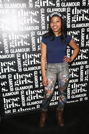 Dominique Fishback was laid-back in a baby tee, leggings, and brown lace-up boots during Glamour's presentation of 'These Girls.'