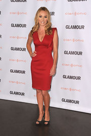 Victoria Smurfit topped off her red cocktail dress with steel-gray peep-toe pumps.