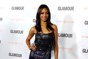 Actress Zoe Saldana arrives at Glamour Reel Moments 2011 held at the Directors Guild of America on October 24, 2011 in Los Angeles, California.