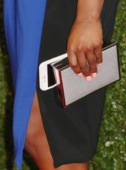 Simone Biles accessorized with a silver box clutch at the 2016 Glamour Women of the Year dinner.
