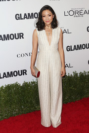 Constance Wu complemented her jumpsuit with a silver tube clutch.