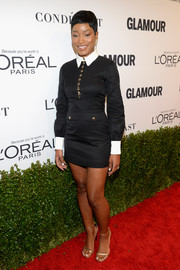 Keke Palmer looked sharp wearing this vintage Yves Saint Laurent shirtdress, in black with gold buttons and contrast collar and cuffs, at the Glamour Women of the Year 2016.