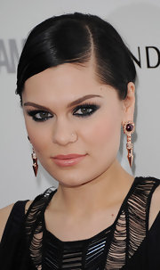 A slick side-parted updo was a dramatic addition to Jessie J's 'Glamour' Women of the Year awards style.