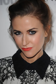 Katherine Kelly puckered up in matte coral lipstick, one of summer's hot beauty trends.