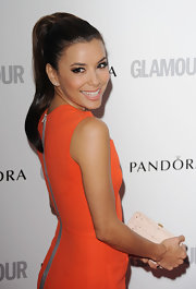 Eva Longoria further streamlined her minimalist sheath dress with a sleek high ponytail.