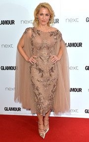 Gillian Anderson was classic and romantic in a caped and beaded nude dress by Paolo Sebastian during the Glamour Women of the Year Awards.