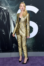 Anya Taylor-Joy worked a gold jacquard pantsuit by Dolce & Gabbana at the New York premiere of 'Glass.'