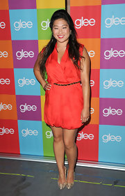 Jenna Ushkowitz teamed her playful orange frock with neutral snakeskin pumps.