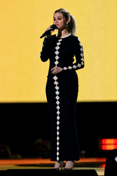 Selena Gomez spoke onstage at the Global Citizen VAX LIVE wearing a diamond-patterned maxi sweater dress by Victor Glemaud.