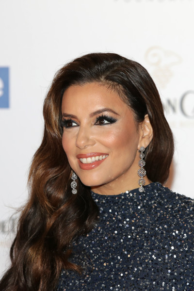 Eva Longoria looked glam with her long wavy hairstyle at the Global Gift Initiative event.