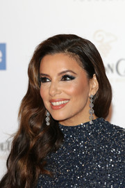 Eva Longoria accessorized with a chic pair of dangling spheres.
