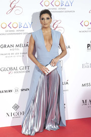 Eva Longoria took a sexy plunge with this ice-blue and silver jumpsuit by Genny at the Global Gift Gala 2017.