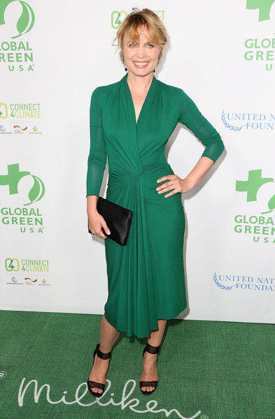 Radha Mitchell paired her chic dress with black mesh ankle-cuff sandals.