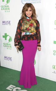 Paula Abdul finished off her outfit with a long mermaid skirt in a striking magenta hue.