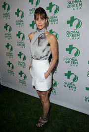 Alexandra opted for a silver halter top and a white skirt for the Global Green pre-Oscar party.