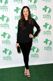 Catt finished off her all-black ensemble with minimalist strappy sandals.