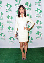 Julia Jones complemented her fitted white frock with patent leather platform pumps.