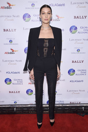 Bella Hadid teamed her suit with a black lace-panel tube top.