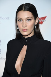 Bella Hadid was casually coiffed with this straight center-parted style at the Global Lyme Alliance Gala.