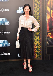 Perrey Reeves went for ultra-feminine styling with a pair of flower-embellished strappy sandals.
